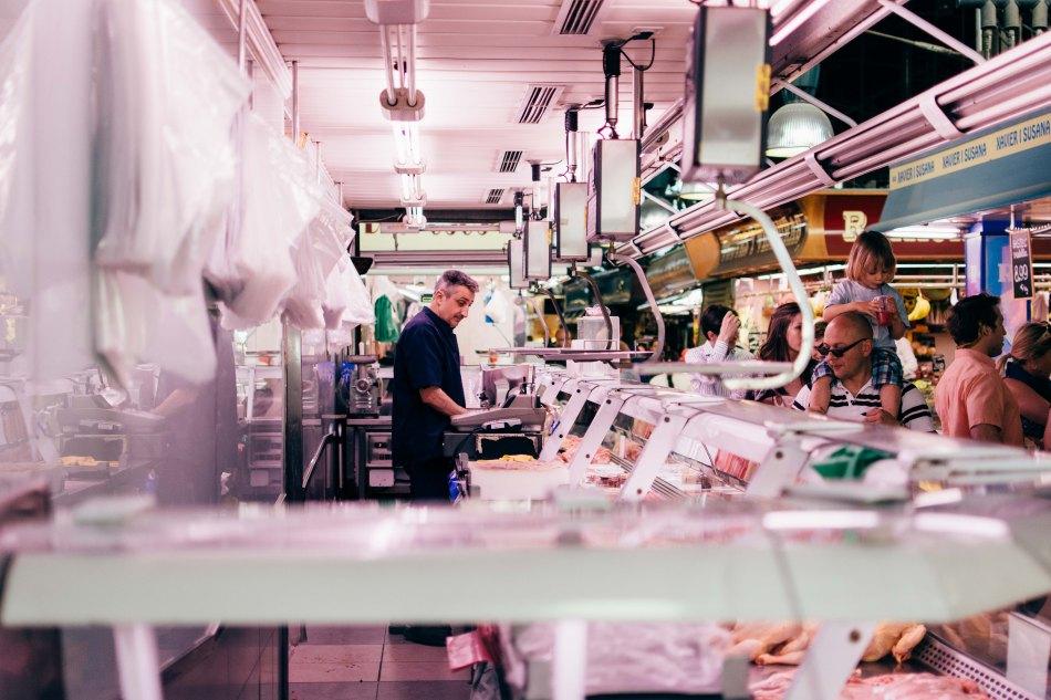 A man meat stall in La Boqueria.